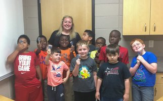 Bob & Betty Courtway Middle School families enjoyed the sweet side of recycling and sustainability education during their spring STEM Night. Recycling educator Whitney Reuschling walked participants through the creation of their own edible landfill cells.